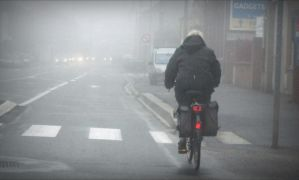 cyclist in mist by April-Mo