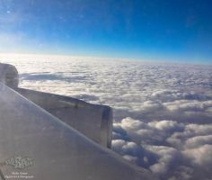 Flying above the clouds by zooz898