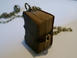 Leather Strapped Book Necklace by JanDaJewelry