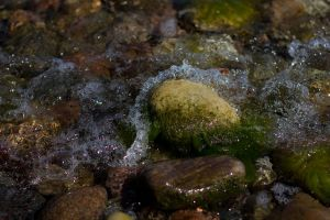 Water rolling over stone by CathexisDk