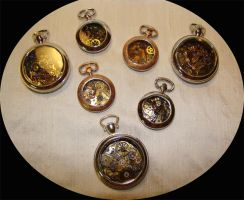 Pocket watches by thedelicateterror
