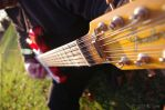 My hubby playing guitar by MorticiaMorte