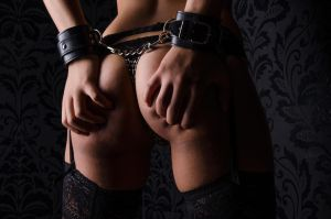 ass and handcuff by DNFotodesign