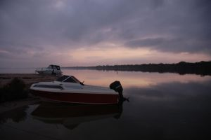 Sunrise on a boat in a lake by jak22