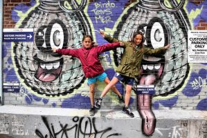 D'Arcy and Kierra:  Posing with the Grafitti by basseca
