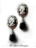 New stud earrings 'Skeletal lady' by TheSpiderStratagem