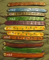 Leather Bracelets by TheScreamingNorth
