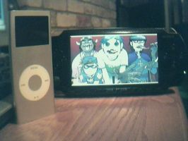 My PSP and my Bro's iPod by FoxTail8000