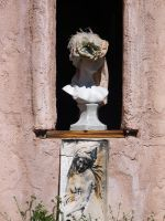 Bust with hat in window by fotophi