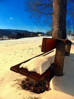 Snow covered bench in winter scenery by patrickjobst