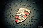 Porshe badge under the rain... by S6T9N