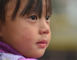 Timphu - Child's smile by LLukeBE