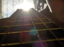 A loaded six string on my back by 99-in-the-shade
