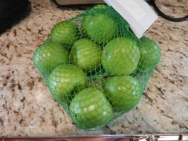 Green apples in a mesh bag by dth1971