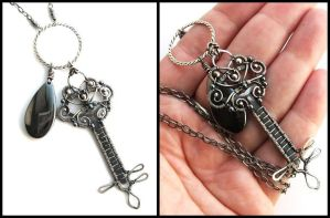 silver and hematite key by annie-jewelry