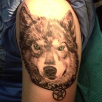 Black and grey wolf tattoo by IAteAllMyPaste