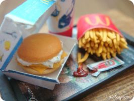 Close up of miniature burger by Aiclay