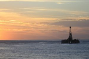 Oil Rig At Sunset by tmz99