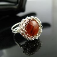 Fine silver wire crochet ring with faux amber cab by CatsWire