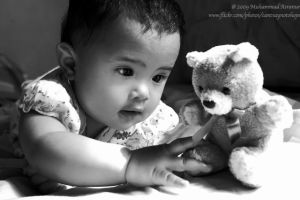 Playing with my teddy bear by cantsaynotohope