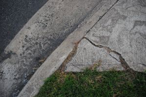 Cracked footpath by Renegade-Hamster