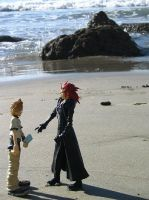 axel and roxas at the beach 2 by blackbird-sing