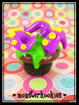 Chocolate Tentacle Cupcake by monsterkookies