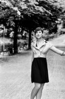 Woman walking in a park by DWaschnigPhotography