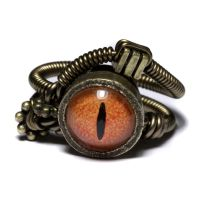 Orange steampunk eye ring by CatherinetteRings