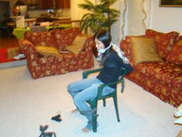 Nina and a chair by BigRedIrony