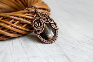 Copper pendant with tiger eye by Schepotkina