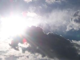 . sunburst in the clouds . by loverlyness