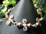 Copper Bicones On Silver Spirals Bracelet by BacktoEarthCreations