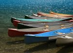 Coloful Canoes 8942047 by StockProject1
