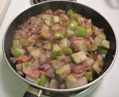Cooking Shallots, Chayote Squash, and Jowl Bacon by Windthin