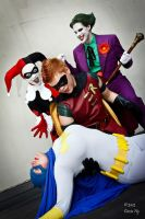Robin Stunned while the joker laughs on by ComicChic19