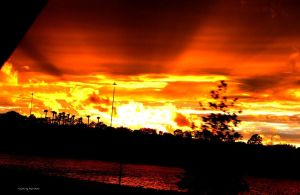 An Exploding Sunset Florida by gdsbngd2me