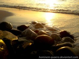 Stones on the beach by Hominem-quaero