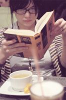 reading in a cafe by prince-Axel