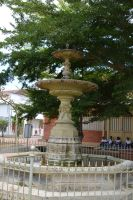 Fountain and seatting schoolchildren of Carbet by A1Z2E3R