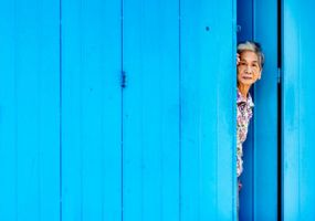 Old lady at shophouse in by bobdoom