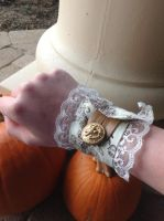 Wrist Cuff 2: Tea stains and an Eagle by Plush-KittyCat