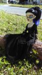 Raven sitting on a log 1 by autumnrose83