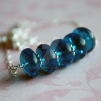Blue glass necklace by dbvictoria
