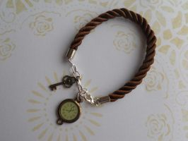 Bracelet with small pendants - watch and key by SteamJo