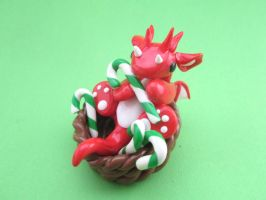 Candy Cane Dragon in a basket by KriannaCrafts