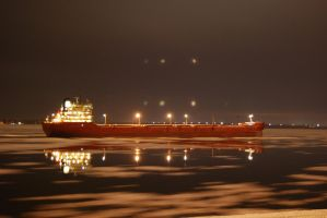 Cargo boat at night by Swatmax