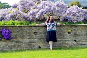 A Wisteria Bush Not Behind The Wall She Leans On by aegiandyad