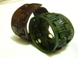 Leather Cuffs by OfTheGodsBlood