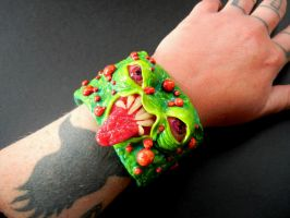 pus face cuff by dogzillalives